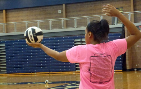 Hit man:  Junior Katherine Nealy serves the ball during Varsity Volleyball practice .