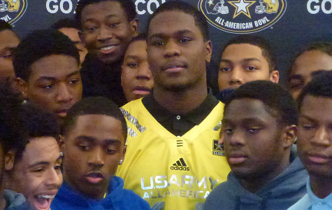 Fan Favorite: Schoolmates surround senior Malik McDowell at Southfield High as he is named to the United States Army's All-American football team.