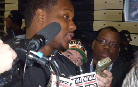 Signing Day: Sports reporters swarm senior football player Malik McDowell on National Signing Day. McDowell announced he wants to play for Michigan State University.
