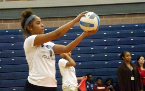 Point well taken: Senior Malaika McCray prepares to serve the ball in a game against the teaching and coaching staff.