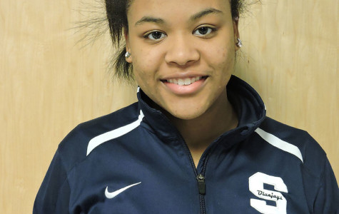 Junior Kristilynn DeFoe hopes to win a basketball contest.