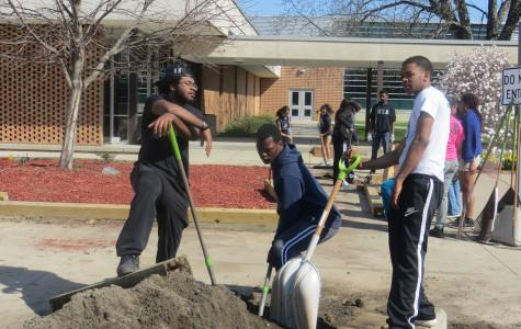 Adding new dirt to the Southfield High flower beds was part of Clean-Up Day.