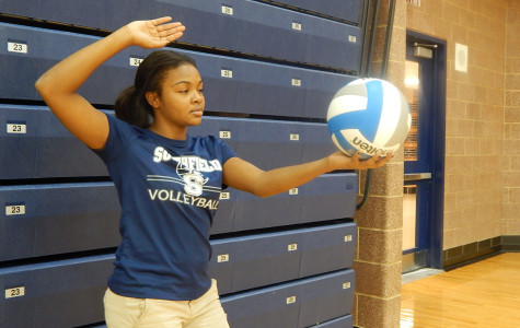 Bam:  Junior Mikaela Barr  serves the volleyball. Barr is the libero for the Lady Jays
