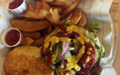 """Burgers and fries - that's what Fuddrucker's is known for. Pictured is the """"The Works"""" - a burger with smokehouse bacon, American cheese and grilled mushrooms . Fries, too."""