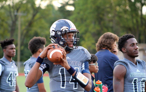 Rising star: Clutching the football is freshman quarterback Sam Johnson III.  Southfield hasn't had a freshman as starting quarterback since Dajuan Warren in 1999.