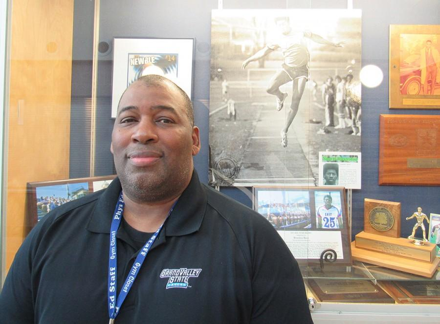 Finish Line: Retiring Coach Vincent Bean  stands in front of the school's showcase filled with some of his years of awards for track, football and basketball when he was a high school student at Southfield High. Bean came back to teach at his alma mater.