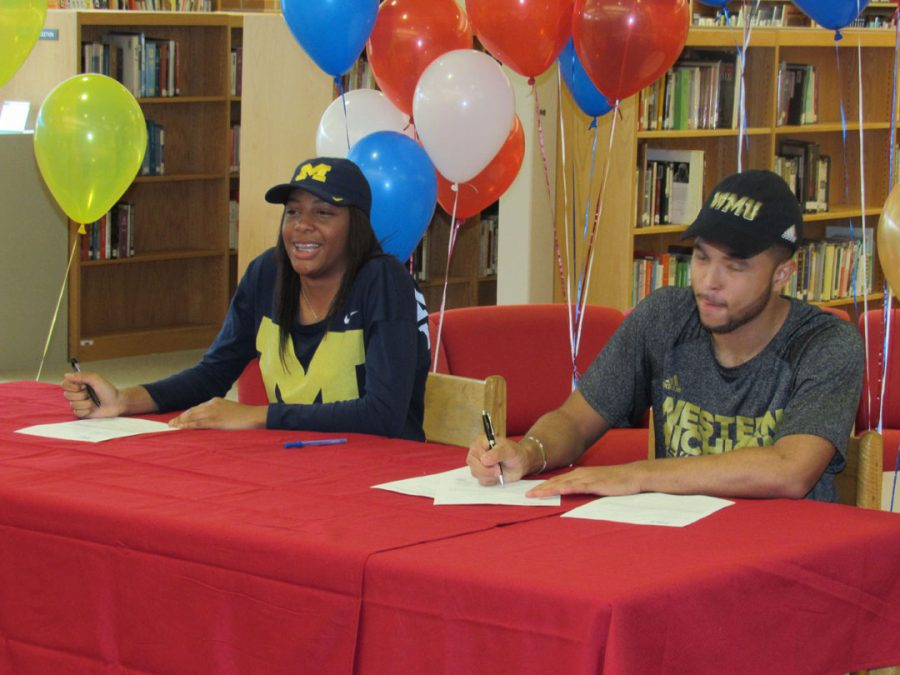 Seniors+Deja+Church+and+Michael+Flowers+sign+their+letters+of+intent+to+play+college+basketball.+Church++signed+with+The+University+of+Michigan%3B+Flowers+chose+Western+Michigan+University.