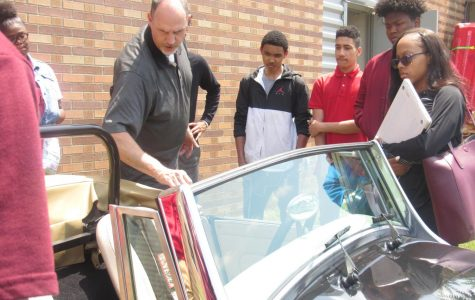 Students Interact While Mr. Martin Highlights Classic Cars