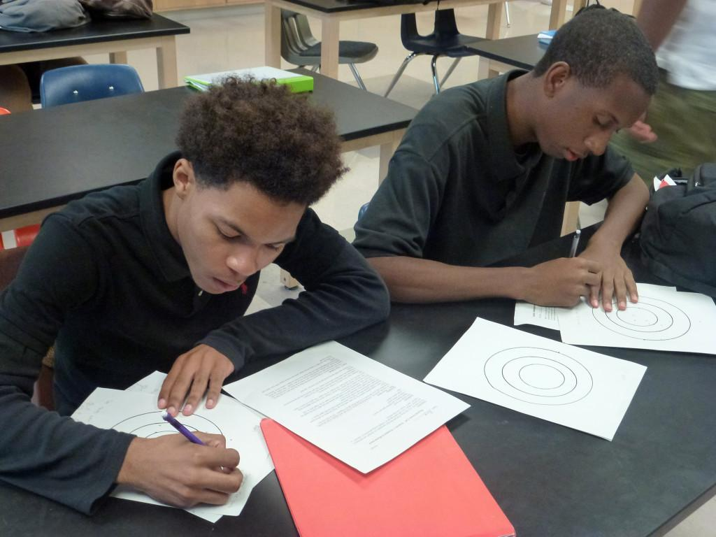Paper work: Senior Arron Williams (left) and DeRon Dennard complete an assignment on precision and accuracy for Bruce Shepard's Physics class.