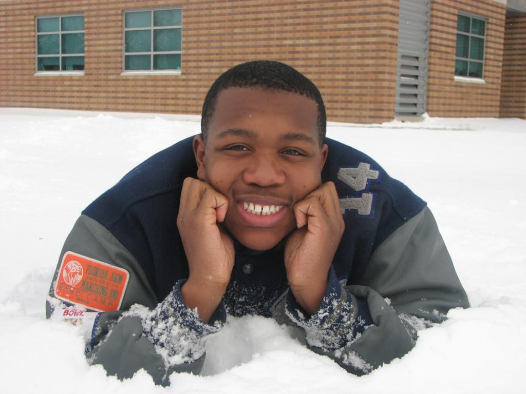 Snow man: Senior David Battle used his six snow days off from school to prepare for his baritone solo in the Solo & Ensemble Festival, where he earned a top rating. Here he's lounging in Southfield High's back yard snow.