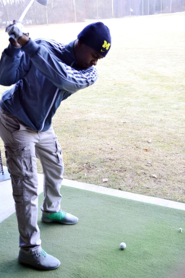 Stroke of luck: Senior Demetrius Jackson practices his swing on the driving range at Beech Woods Golf Course.