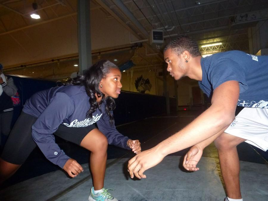 Wrestlemania: Senior wrestlers Adriana Echols (left) and Alias Broadnax practice their takedown moves in the upper level of the old gym.
