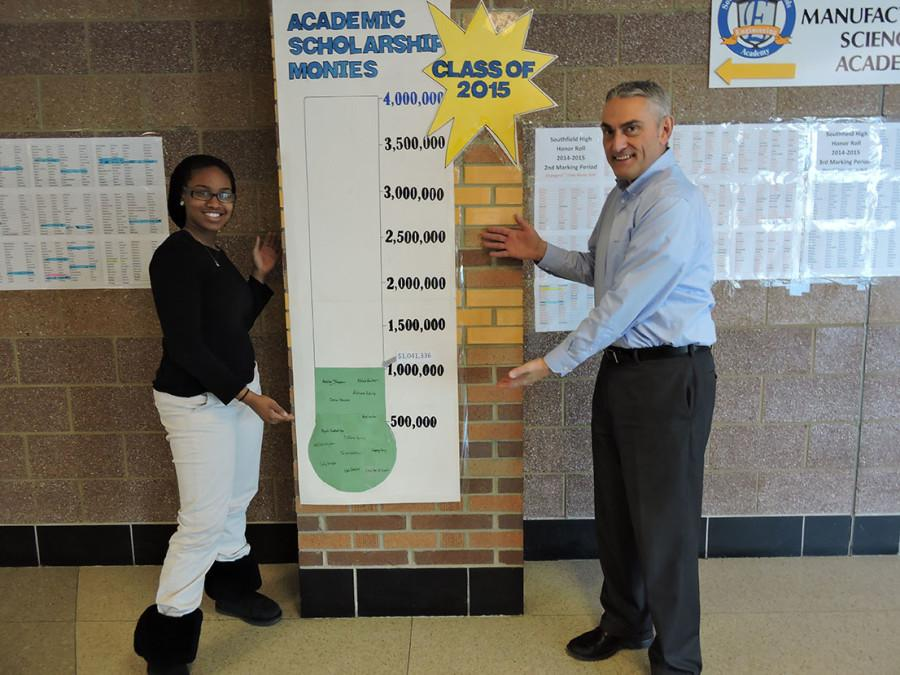 Senior Adriana Echols and Counselor Thomas Holliday show off the new scholarship thermometer.