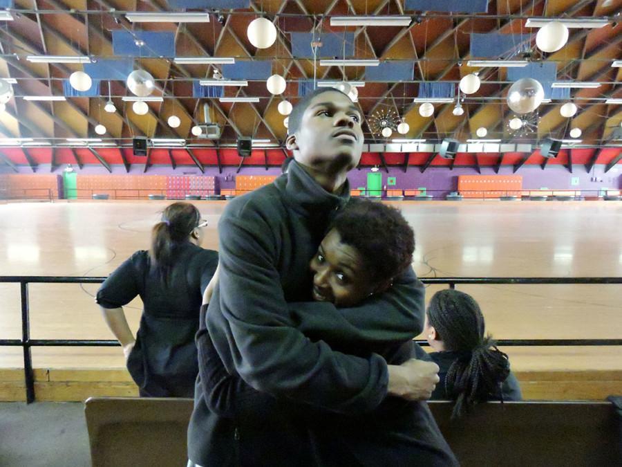 Senior Clifton Padgett hugs senior Armani Phillpots during a break from skating.