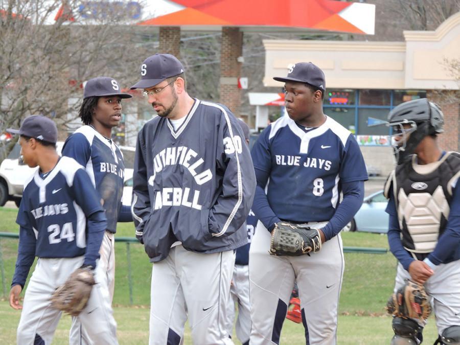 Baseball Coach Jamie Glinz (center) gets his players ready for the season.