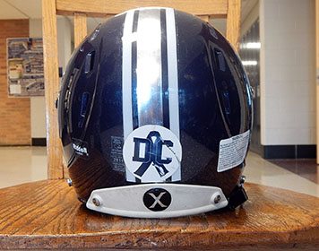 """Memories: The """"DC"""" stickers on the back of the football team helmets this season are tributes to the late football player Darius Cooley."""