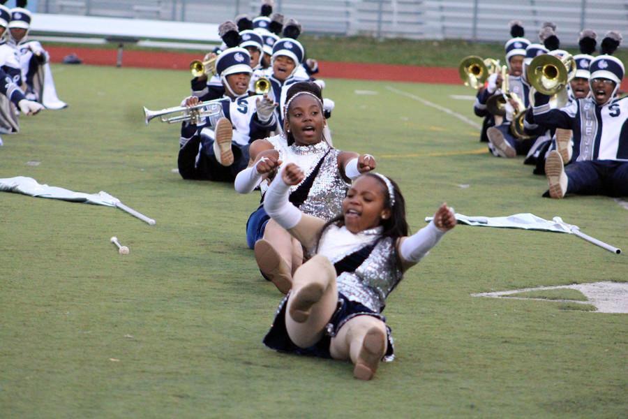 Junior Kennidi Holloway dances at the football game.