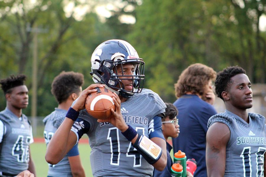 Rising star: Clutching the football is freshman quarterback Sam Johnson III.  Southfield hasn't had a freshman as starting quarterback since Dajuan Warren in 1999.