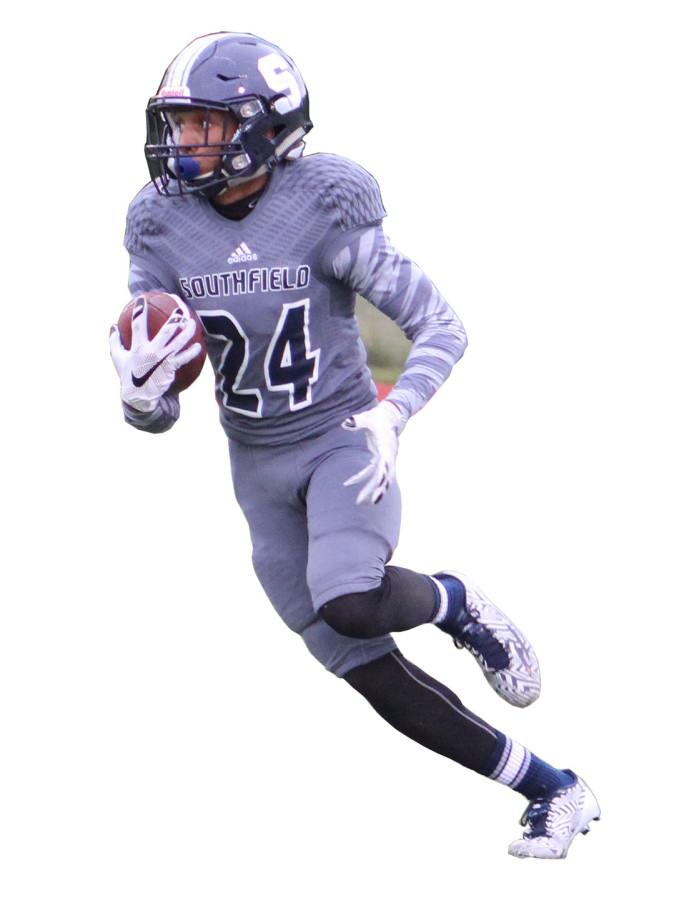 Run%2C+Josh%2C+Run%3A+Senior+wide+receiver+Joshua+JP+Pickens+demonstrates+what+he+does+best.+He+cradles+the+football+and+picks+up+yardage+for+the+Blue+Jays.+