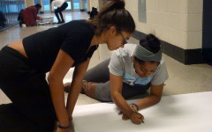 Sophomore members of the Southfield Student Congress Alaris Wiggins and Mya Brooks collaborate on a wall decoration for the hall decorating contest.