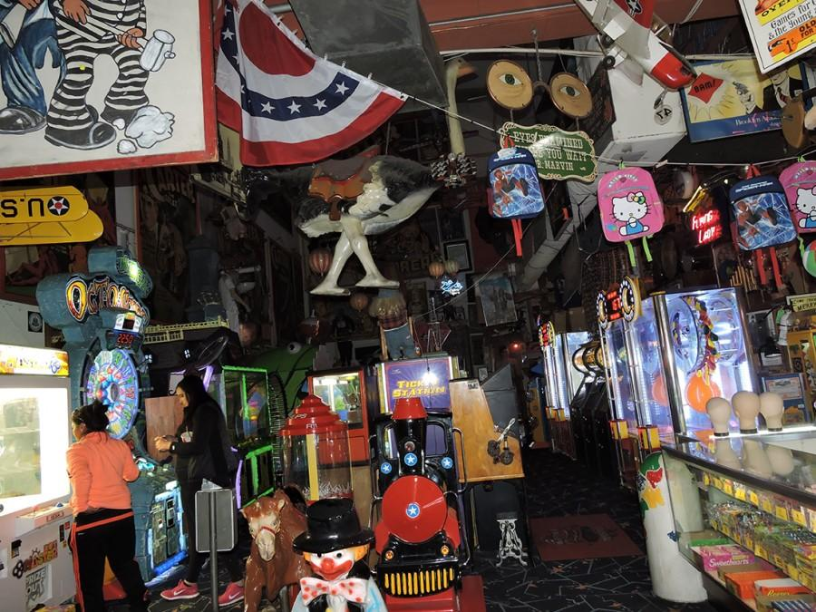 Besides coin machines, flags and vintage posters are also part of the fun at Marvin's museum.