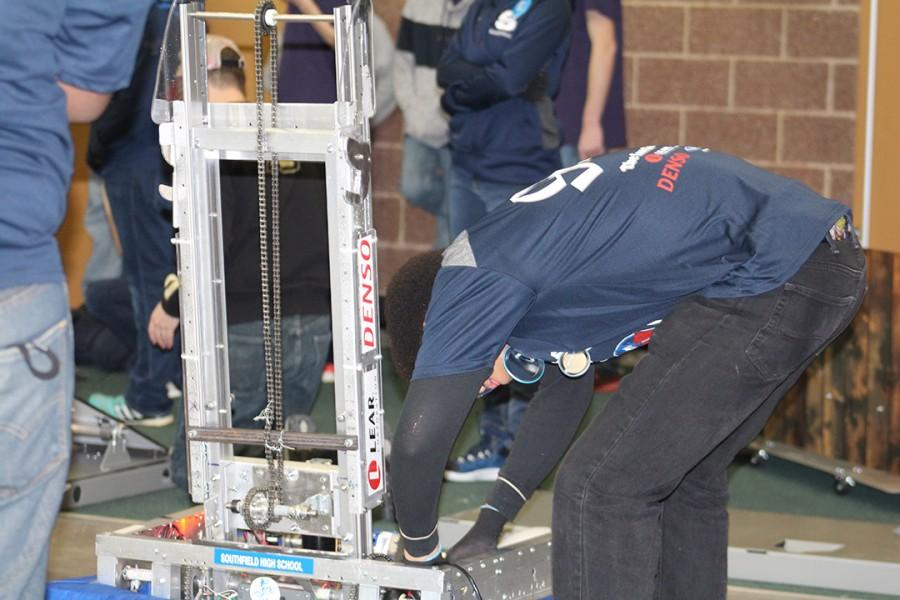 Techno+Jays+team+member+Etaune+Johnson%2C+a+senior%2C+makes+last+minute+adjustments+to+the+Southfield+High+robot.+The+Techno+Jays+finished+in+tenth+place%2C+out+of+40+teams.