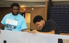Senior Kaelan Owens (left) and senior Telvin Ayala prepare the drivers station for Robotics competition. Southfield High is hosting the competition for the third consecutive year.